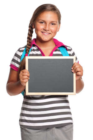 Schoolgirl with small blackboard - isolated on white background photo