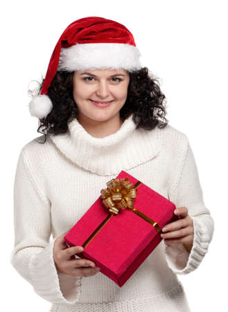 Christmas girl holding gift wearing Santa hat over white background photo