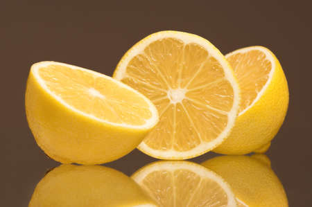 Slice of fresh lemons isolated on grey background photo