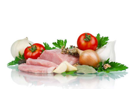 Fresh vegetables and meat on white background photo