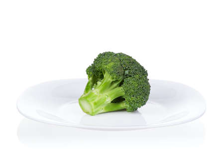 Fresh ripe broccoli piece on plate on white background Stock Photo - 15817878