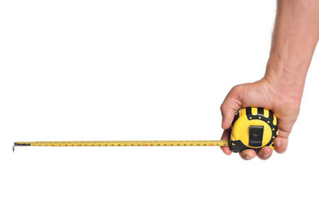 measure height: Man hand with tape measure isolated on white background Stock Photo