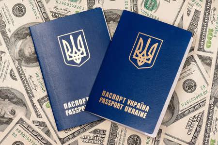 Two international Ukrainian passport on US dollars background Stock Photo - 15823113