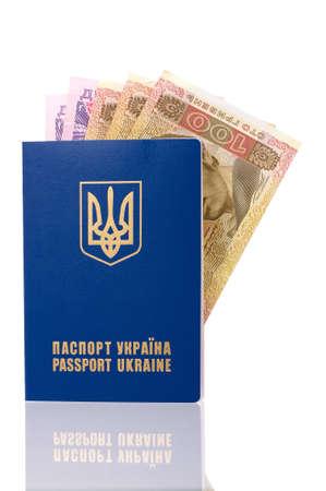 hryvna: International Ukrainian passport with Hryvna banknotes isolated on background