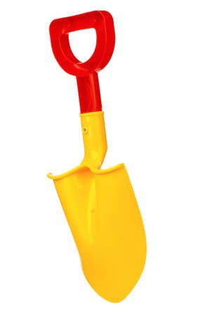 Toy small spade isolated on white background photo