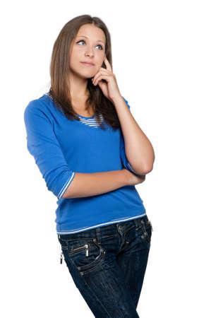 teenager thinking: Retrato de un modelo muchacha encantadora adolescente posando sobre fondo blanco Foto de archivo