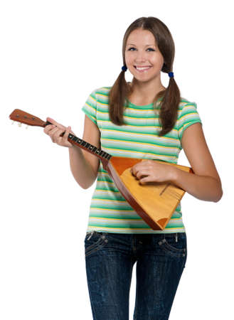 Beautiful teen girl with balalaika posing on white background photo