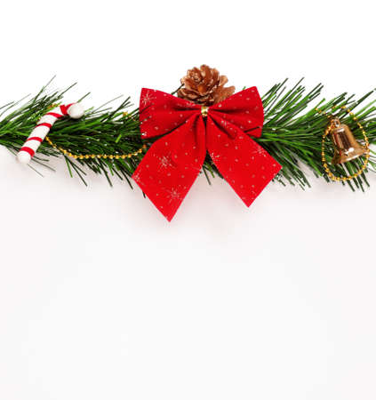 Christmas green artificial branch and red bow with empty board on white background photo