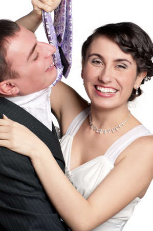Portrait of happy bride and groom on white background