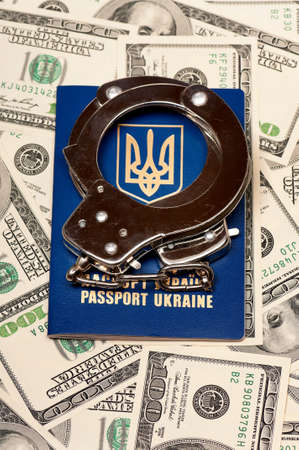 International Ukrainian passport with handcuffs on US dollars background Stock Photo - 15935693