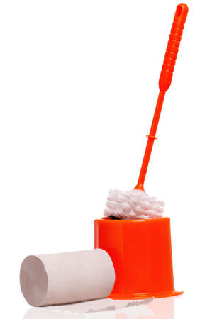 Plastic orange toilet brush and paper isolated on white background photo