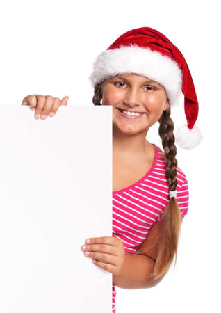 Portrait of happy girl in Santa hat with white blank photo