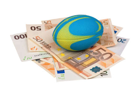 debt goals: Small rugby ball on heap of euro isolated on a white background