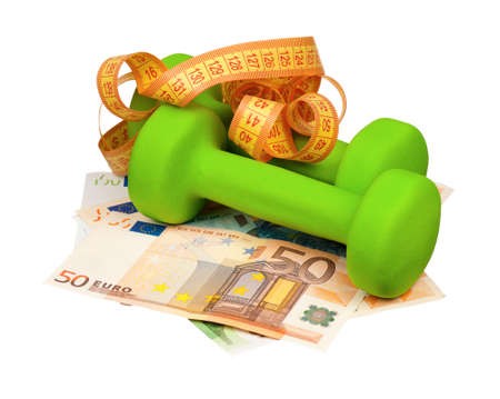 Dumbbells with measure tape on heap of euro isolated on a white background photo