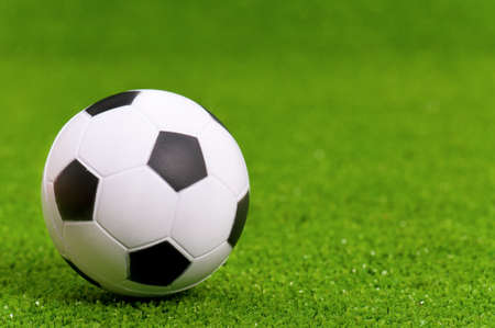 Small classic soccer ball on green artificial grass Stock Photo - 16384911