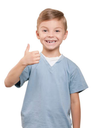 Portrait of beautiful little boy giving you thumb up over white background photo