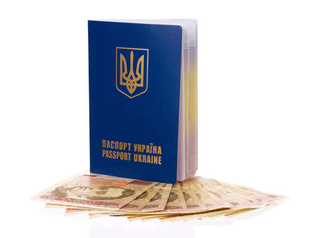 consulate: International Ukrainian passport with Hryvna banknotes isolated on background