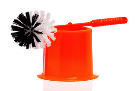 Plastic orange toilet brush isolated on white background photo
