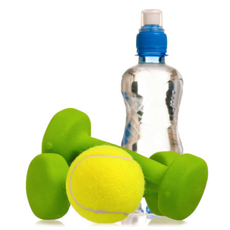 Tennis ball with dumbbells and bottle of water isolated on white background photo