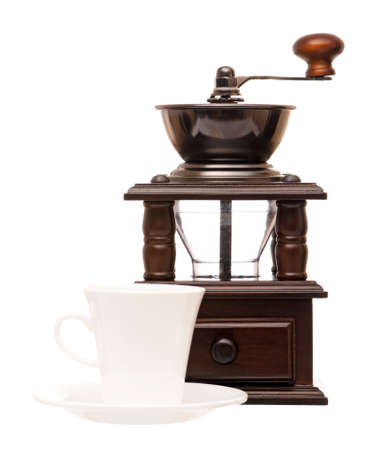 Vintage coffee grinder with cup, isolated on a white background photo