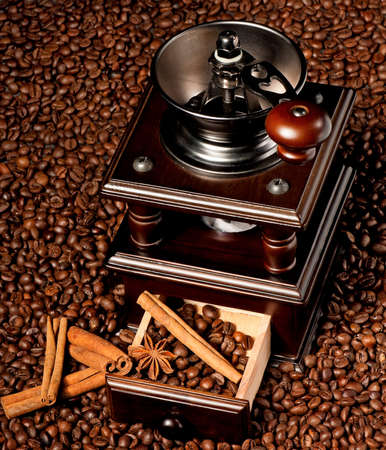 Manual coffee grinder with coffee beans and spices photo