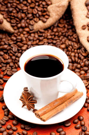 Cup of coffee with spices and lump sugar photo
