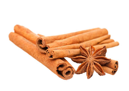 Cinnamon sticks and star anise isolated on white background photo