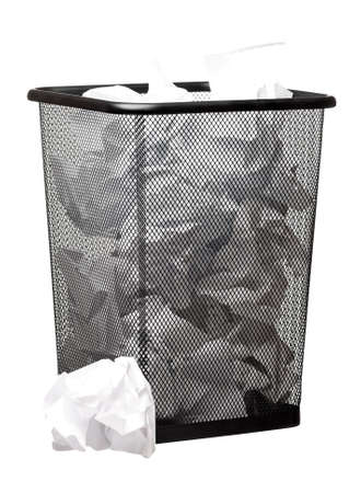 Garbage bin with paper waste isolated on white background photo