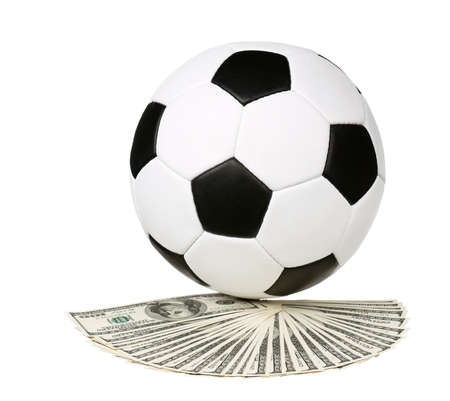Soccer ball on heap of dollars isolated on a white background photo