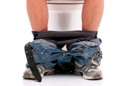 Man is sitting on the toilet bowl, on white background photo