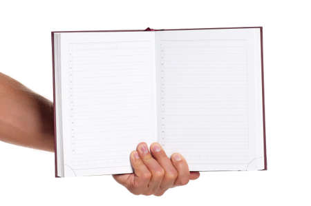 Man hand with a notebook isolated on white background photo