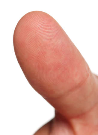 Macro view of a finger print on a human thumb isolated on white background photo