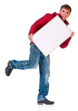 Full length portrait of a young man in winter clothing with empty white board isolated on white background photo