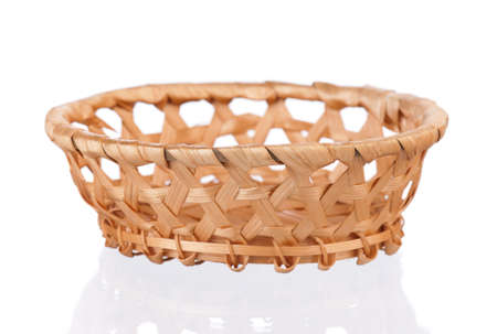 Empty small wicker basket isolated on white background Stock Photo - 17579288