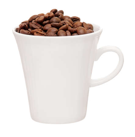 White cup with coffee beans isolated on white background Stock Photo - 17579087