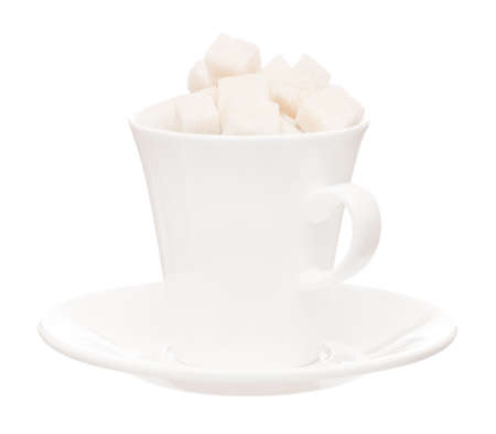 deleterious: Small white cup with saucer and lump sugar isolated on white background