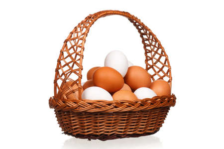 Brown and white eggs in the wicker basket over white background Stock Photo - 17939011