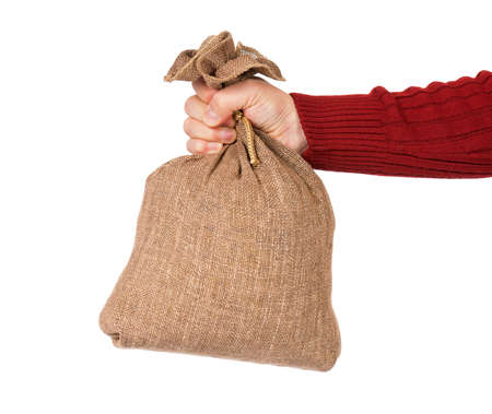 Man hand with small burlap sack on white background photo