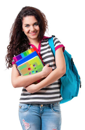 Beautiful student girl with backpack and books, isolated on white background photo