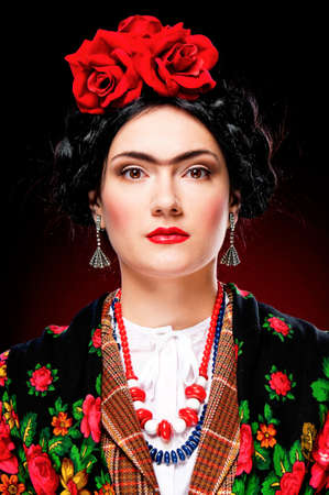 Elegant lady with dress and hairdo like Frida photo