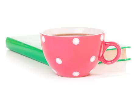 mugged: Big mug polka dot of tea and book, isolated on white background Stock Photo