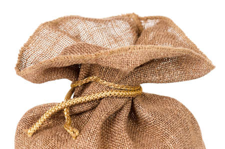 Close-up of small burlap sack on white background photo