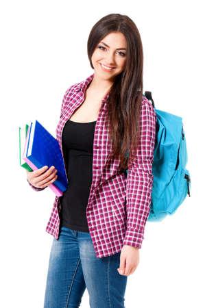 colegiala: Hermosa chica estudiante con mochila y los libros, aislados en fondo blanco Foto de archivo