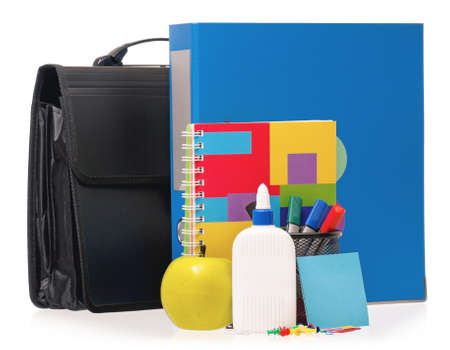 Big blue folder, briefcase, markers, exercise book and green apple isolated on white background photo