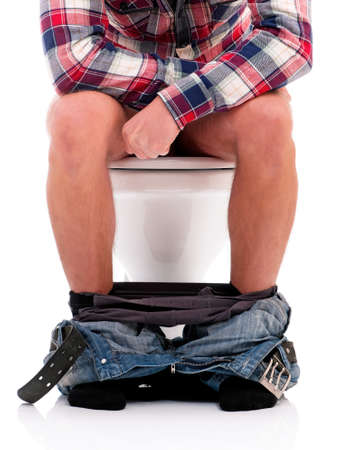 public toilet: Man is sitting on the toilet bowl, on white background Stock Photo