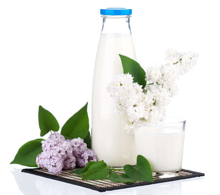 dairying: Bottle of milk with lilac branch isolated on white background