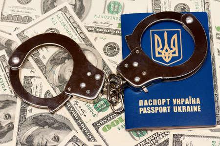 International Ukrainian passport with handcuffs on US dollars background Stock Photo - 19253124