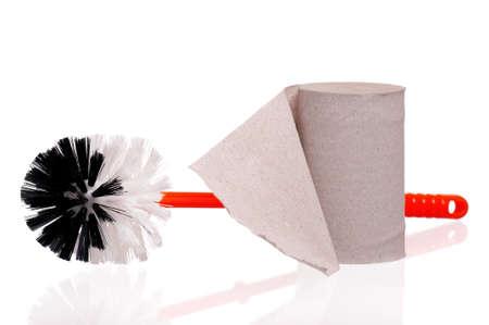 Plastic orange toilet brush and paper isolated on white background Stock Photo - 19272148