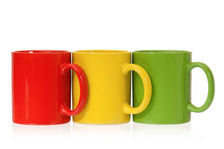 mugged: Three colorful mugs for coffee or tea, isolated on white background Stock Photo