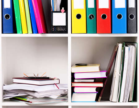 order chaos: File folders, standing on the shelves at office